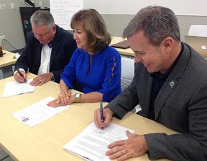 Sam Minner, Barbara Damron and Richard Bailey sign an MOU